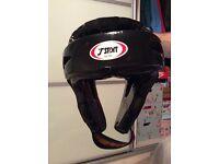 T Sport dipped foam head guard. Size Medium. Unused.