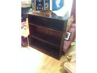 Solid oak bookcase , with adjustable shelves. Size W 44in D 10.5in H 44in. Free local delivery.