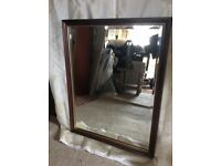 Matching dark wood frame mirrors
