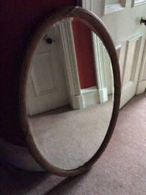 Large antique gilt oval mirror