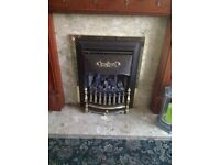 Gas fire with marble granite plinth and back and wooden surround