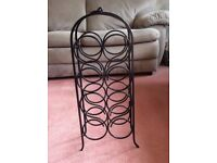 Black metal wine rack
