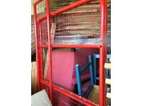 Red metal frame bunk beds