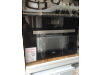 Beko intergrated compact multi function oven with microwave. £310 RRP£450 new/graded 12 month Gtee