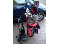 Set of used golf clubs and woods with Titliest bag and trolley