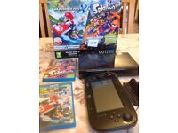Wii u console with mario kart 8 and splatoon with box