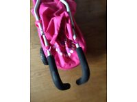Child's buggy / stroller in pink.