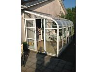 Sectional Sunroom attached to house, also suitable for use as a Greenhouse