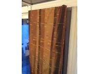 Pair of copper coloured curtains in mint condition.