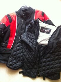 Red and black akito motorbike jacket with separate thermal lining.