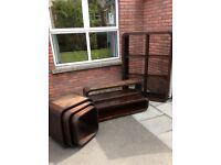 Solid Walnut Dekko living room furniture includes bookcase, coffee table, nest of tables and shelf