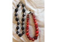 Necklaces - 1 black and 1 Red beaded necklaces