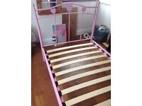 Girls pink metal bedstead in good condition