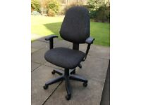 Attractive and well appointed office/recliner/arm rest black chair