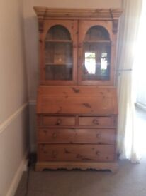 Pine cupboard with display cabinet , drawers and desk section