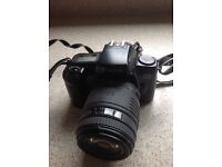 Canon EOS 1000 F 35 MM. camera with Sigma 70-210mm zoom lense