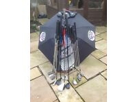 Complete set of golf clubs including golf trolley
