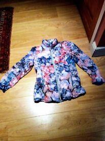 Danish-make, ultra light, downfilled, floral patterned jacket. bag. Size 10/12.Worn twice.