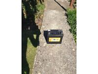 Car battery and towbar for sale.