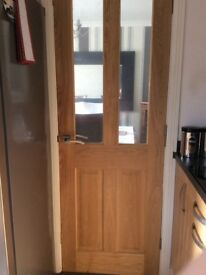 New oak door with glass