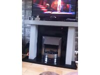 Lovely electric fire place and surround