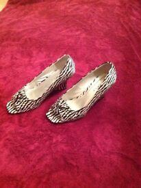 Lunar black and cream shoes