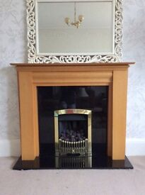 Granite inset gas fire and wood surround