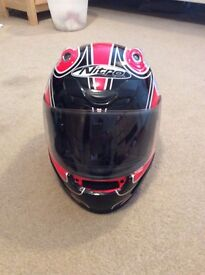 Red nitro motorcycle helmet size small