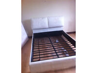 Leather double bed frame with cushioned headboard