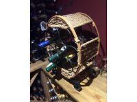 Cast iron and rattan wine rack