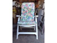 2 High backed, white, reclining, garden chairs plus fitted cushions.