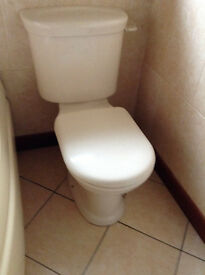 Royal Doulton Pergamon (off-white) washhand basin and matching toilet cistern.