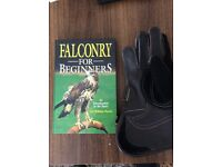 Falconry book and leather glove