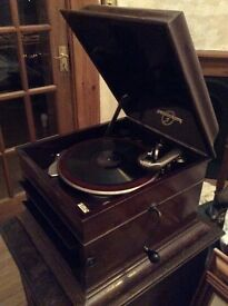 Gramophone with approximately 130 - 78rpm records and cabinet