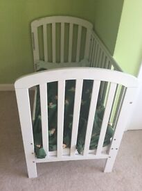 White drop side cot