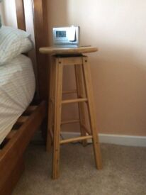 Wooden stool with revolving seat