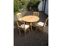 Light wood kitchen table and chair. Excellent condition.
