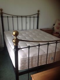 Iron and brass king size bed complete with very little use nearly new mattress. Excellent condition