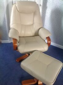 Leather recliner armchair and footstool
