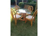 Rattan table, 4 chairs and settee