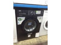 Beko black washing machine. 8kg 1400spin A+++ energy rated. New/graded 12 month Gtee