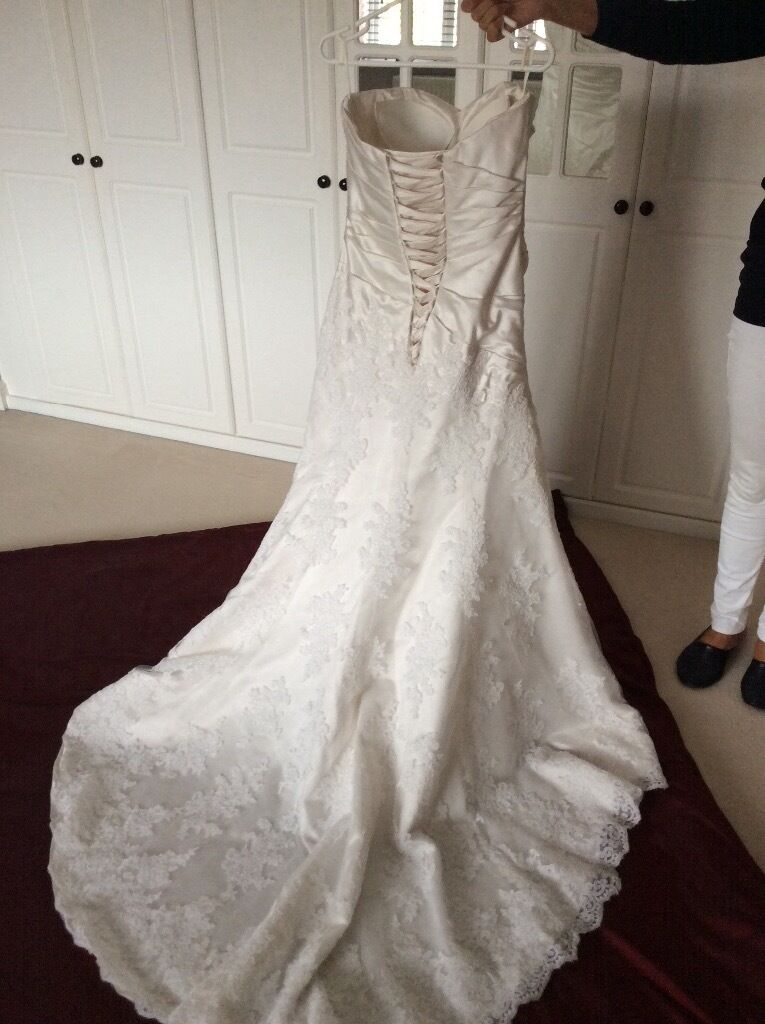 Wedding Dress Size12in Bradley Stoke, BristolGumtree - Wedding Dress, Size 12, Ivory . Worn only once and professionally cleaned post wedding. Satin bodice with lace overlay skirt and train, sweetheart neckline with laced up back. ( See photographs)