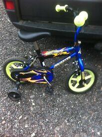 Boys bike with stablizers