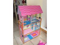 Pink toys storage unit dolls house