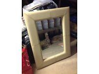 Cream leather framed mirror