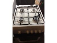 Gas cooker, white in colour, good condition.