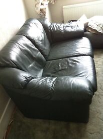Leather three piece suite (sofa and armchairs)
