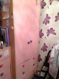 Pale pink wardrobe with 3 drawers