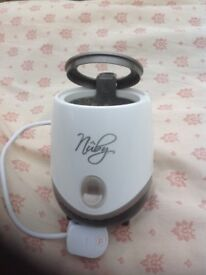 """Nuby"" natural touch bottle warmer"