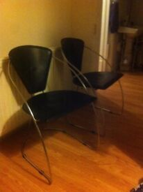 2 leather and chrome chairs